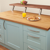 Feature oak kitchen island with shaker doors painted in blue ground