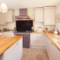 Oak kitchens painted in Farrow & Ball Elephant's Breath