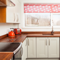 Oak shaker kitchen painted in Farrow & Ball's Mizzle, with walnut worktops