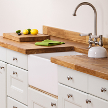 Oak worktops are traditional and charming, and perfect for vintage solid wood kitchens.