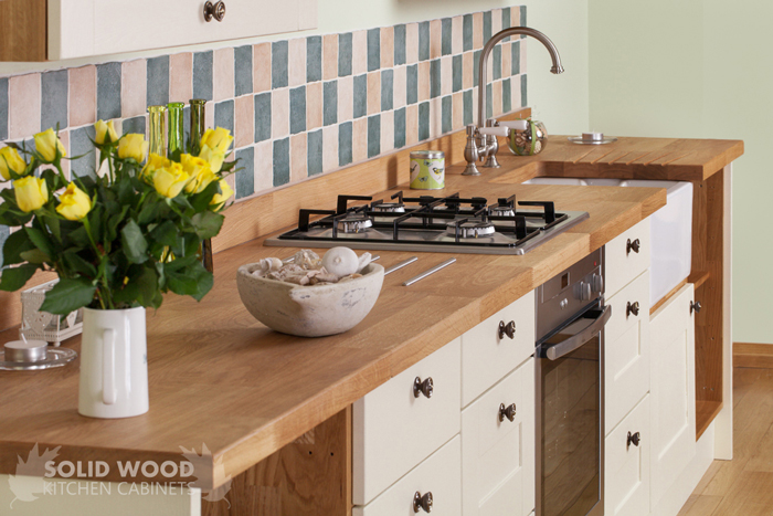 deluxe prime oak worktops with solid oak kitchen cabinets painted in new white