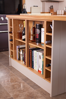 Open shelving units in oak kitchens is ideal for storing recipe books close to hand