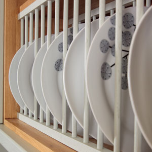 Plate racks are a practical choice that look great in a traditional kitchen