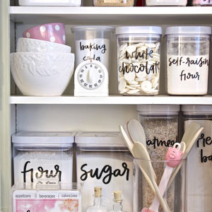 The owner of this pantry cabinet has decanted everything into coordinating containers for an organised, cohesive look.