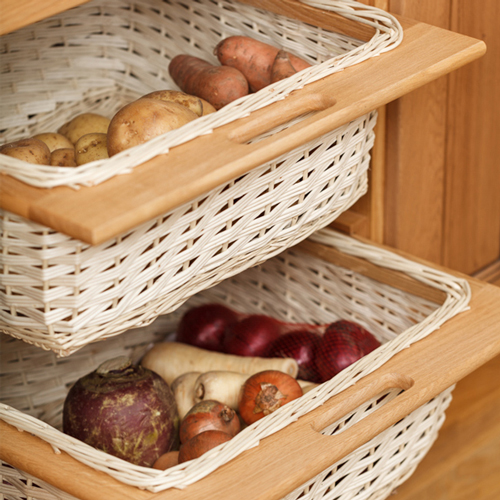 Wicker baskets within solid oak kitchen cabinets
