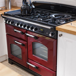A red range oven in a neutral kitchen