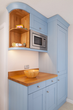 Sophisticated Shaker cornices and pelmet look splendid in this Lulworth Blue kitchen