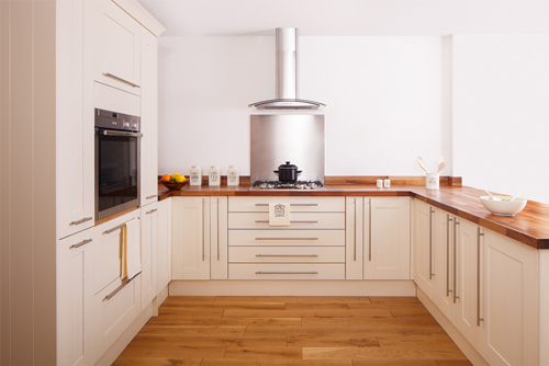 These Shaker frontals are painted in New White contrast nicely with the walnut worktop.