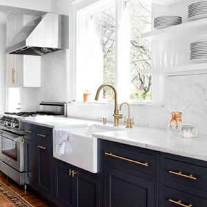 These shaker kitchen cabinets show that dark does not equal dingy in this bright shaker kitchen featuring tuxedo cabinets