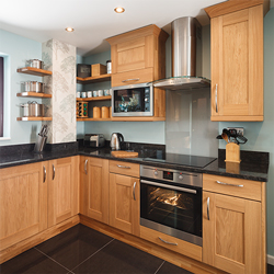 Shaker lacquered oak cabinets make a beautiful feature in oak kitchens.