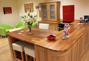Iroko Worktops, solid oak cabinets, shaker lacquered frontals