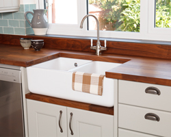 Double-bowl Belfast sink with a sink cabinet and Deluxe black American walnut worktops.