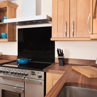 Solid oak kitchen in shaker style with American walnut worktops
