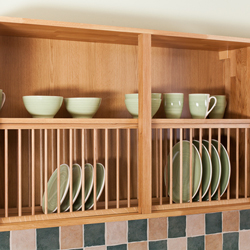 Solid oak plate racks provide both attractive and convenient storage for crockery