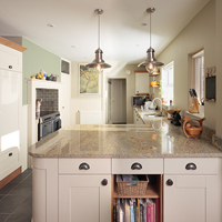 This oak kitchen painted in Farrow & Ball's Lime White complements the light granite worktops