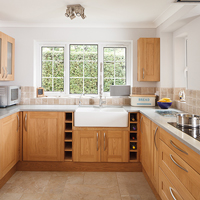 Solid oak Shaker lacquered kitchen with composite worktops and Belfast sink