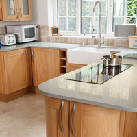 Solid oak Shaker lacquered kitchen with slim hob and overhanging breakfast bar