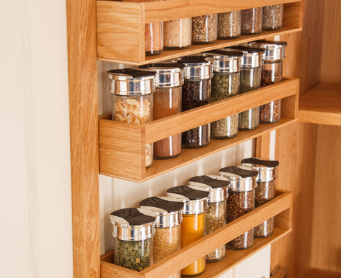 A solid oak spice rack is a fantastic addition to any kitchen unit, working especially well in a full height kitchen larder.