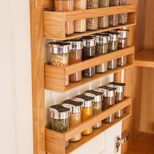 Our solid oak spice racks fit neatly to the inside of a cabinet door, leaving valuable space inside free - a small kitchen design idea not to be overlooked!