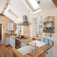 Oak kitchen with full stave oak worktops, painted in Farrow & Ball's Blue Ground