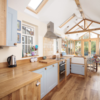 Traditional oak kitchen with full stave oak worktops and cabinets painted in Farrow & Ball's Blue Ground