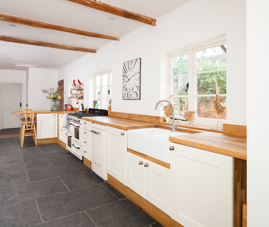 A One Wall Traditional Kitchen With Full Stave Oak Worktops And Cabinets  Painted In Farrow