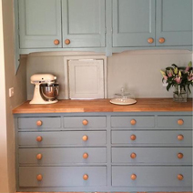 Team solid oak worktops with Farrow & Ball's Oval Room Blue for a gorgeous colour contrast.