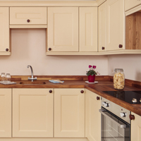Solid wood kitchen finished in Farrow's Cream