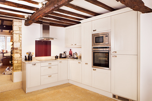 Solid wood kitchen with frontals painted in Farrow & Ball's All White.