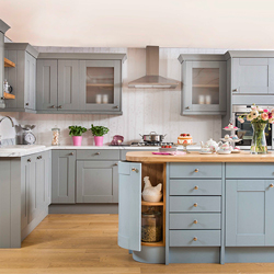 A solid wood kitchen with mis-matched worktops and a blue island