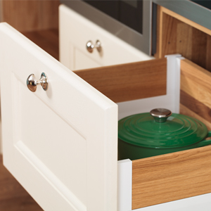 Solid oak drawers provide easily accessible storage space solid oak kitchen cabinets.
