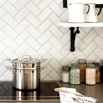 Eye-catching herringbone tiling is an individual and charming addition to oak kitchens oak kitchens.