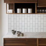 Vertical subway tiling enhances the height of your kitchen oak kitchens.