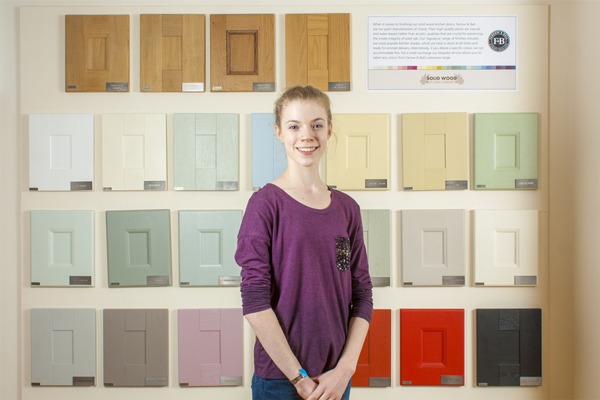 Here is Lucy Waine in our Solid Wood Kitchen Cabinet showroom in Gloucestershire