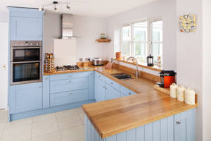 Solid oak kitchen with full stave oak worktops and U-shaped layout.