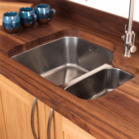 This undermounted sink fits snugly above our solid wood sink housing cabinet.