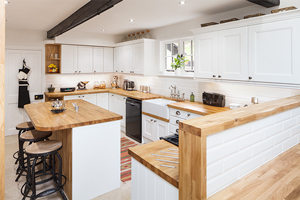 Oak kitchens painted in Farrow & Ball's All White, with oak worktops.