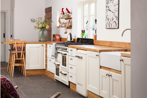The white kitchen doors in this home are the perfect way to create a country style