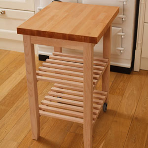 A wooden kitchen trolley in a country kitchen
