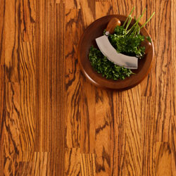 Our gorgeous stripy zebrano worktop with a bowl of herbs