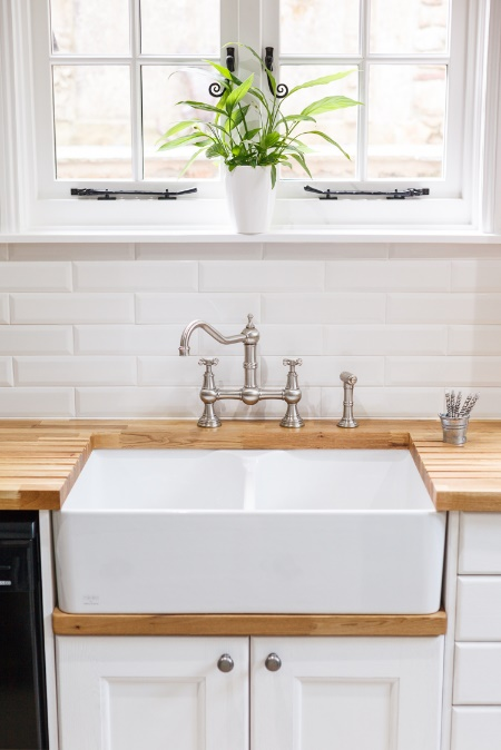 A Belfast sink, like the one pictured here, is a popular option for farmhouse kitchens