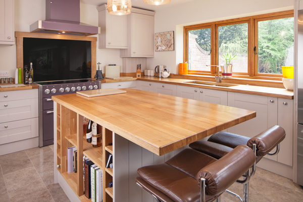 This bespoke kitchen features Shaker doors in Farrow & Ball's Elephant's Breath and full stave prime oak worktops