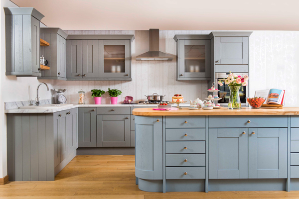 Marble effect laminate worktops alongside Shaker cabinets in Farrow & Ball's Pavilion Grey pair perfectly with ash worktops and Parma Grey cabinet doors on the kitchen island featured here