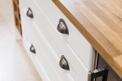 Traditional frontals in Farrow & Ball's All White with a solid oak worktop