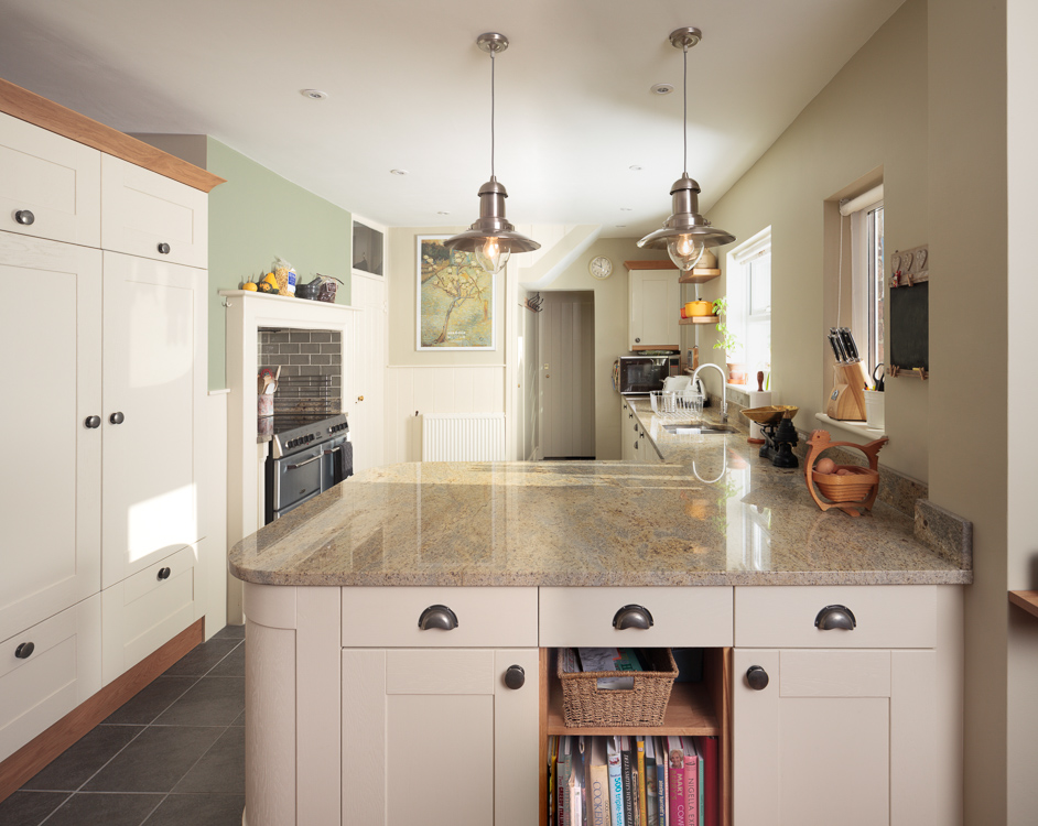 A classic kitchen with earthy wall tones and a granite worktop