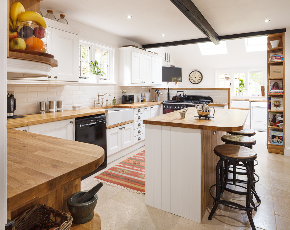 This monochrome farmhouse kitchen ties contemporary and traditional together perfectly, creating a beautiful yet practical space for a busy family home
