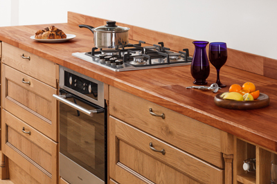 Wooden worktops and upstands with lacquered oak cabinets in a traditional style