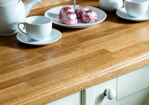 Shaker cabinet doors in Farrow & Ball's Mizzle alongside oak worktops with an ogee profile