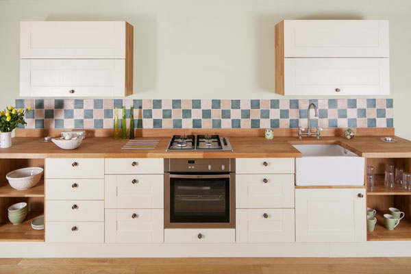Shaker doors painted in Farrow & Ball's New White paired with an oak worktop