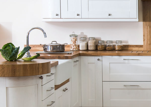 This shaker kitchen features deluxe oak worktops and Shaker cabinet doors in Farrow & Ball's All White